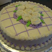 A Cake For A Friend White buttercream, white roses with purple detail