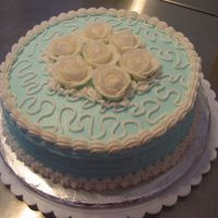 One Of My First Cakes Skyblue buttercream with white roses/borders.I attempted Cornelli lace.