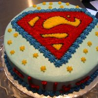 Superman Cake I used the piping gel techique to transfer the Superman logo onto the cake. Filled in with star tip.