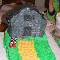 Wizard Of Oz 1/4 Sheet Cake with 3-D House Pan, Captain Crunch for the yellow brick road and Fondant for the legs