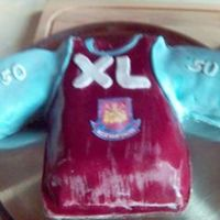 Phplas1Eopm.jpg Football shirt,English Westham. Carved in chocolate cake,filling of jam and buttercream. Coverd in MMF.