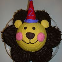 Circus Lion Cake For My Son's 2Nd Birthday  This cake was made using the Wilton circus cat as an inspiration. I used half of the ball pan, and the flower pan. I bought the Wilton...