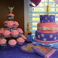 Tinkerbell Cake And Cupcakes  This is the second cake I ever made. I made this cake for my daughter's 3rd birthday this past weekend. It's butter cake (wilton...