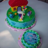 Blues Clues All buttercream except figures. Steve & Blue plastic. Ball & mailbox are Fondant.