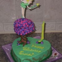 "Tinkerbell BC icing cake and tree top, tree trunk is fondant covered Pillar. 10"" heart cake with 4"" heart cake for tree top. Tinkerbell and..."