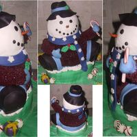 Frosty The Snowman Fondant and buttercream combination cake, my camera doesn't show it well, but his shirt is burgandy, not black.