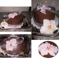 Diabetic Orchid Cake This is a diabetic cake, 0 sugar, and the icing doesn't tip on like BC would, hince why it's edges are so plain. It doesn't...
