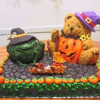 Trick Or Treat I used a sheet cake for the base, iced and detailed to resemble a stone floor which the witch frog cake and the pumpkin-bellied bear sit,...