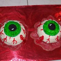 Bloodshot Eyes  I made this cake for a friend's Halloween party. She asked for something gory. The cake is all edible except the wooden skewers. The...