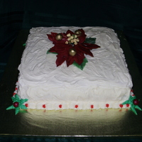 "Christmas Cake - 2009 This was a simple 12"" Red Velvet w/cream cheese square for work. Gumpaste Poinsettia"
