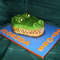 Groom's Cake - Florida Gator Being a die hard LSU fan, I did suggest a Gator Gumbo...grin... Carved Pumpkin Spice Cake with Cinnamon Cream Cheese Filling covered in...