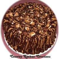 Chocolate And Caramel Snickers Cake Triple Chocolate fudge cake torted with chocolate and caramel icing- frosted with chocolate fudge icing and drizzled with caramel and...