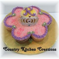 "Small Flower And Tiara Cupcake Cake 8 small cupcakes leftover from larger tiar cupcake cake- made into a flower shape and the ""K"" is for the birthday girl- Kayli"