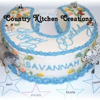 Savanannah's Girly Horse Cake  Made for an equestrian friend of my DD's. She wanted a horseshoe cake- with flowers, blue and green, (her favorite colors), her...
