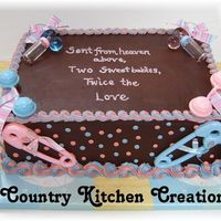 Twins Shower Boy And Girl  9x13 double layer triple chocolate fudge cake- pink and blue together from fraternal twins- one boy and one girl- babies were truely heaven...