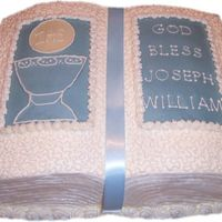 Joseph's Christening Cake Book pan on top of 11x15 sheet cake- cornelli lace- blue and ivory candy clay