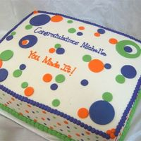 Polka Dot Graduation 11x15 double layer cake- one layer french vanilla one layer triple chocolate fudge with strawberry creme and strawberry puree filling...