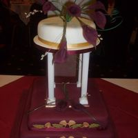 Burgundy Calla Lillies Customer wanted a traditional style wedding cake, but with contemporary colouring. Think that the combination of burgundy, gold & ivory...