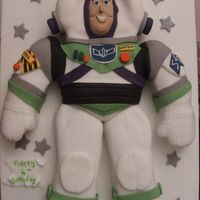 Buzzlight Year - To Infinity & Beyond! 2D buzz using the spaceman wilton cake pan. As I find this pan quite boring I decided to cut the arms & the legs out to give it a bit...