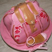 Fashion Forward Mum! Purse is made from chocolate cake. Covered with fondant and decorated with gumpaste. The fashionable wedge is made with gumpaste and...