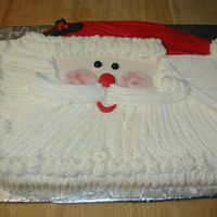 Santa Half sheet shaped into a santa face. All Bc with a fondant hat.
