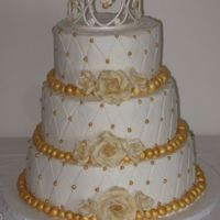 "Princess Birthday 6"", 8"", and 10"" iced in BC, fondant pearls with gold luster dust. Gumpaste roses brushed with gold luster dust and gumpaste..."