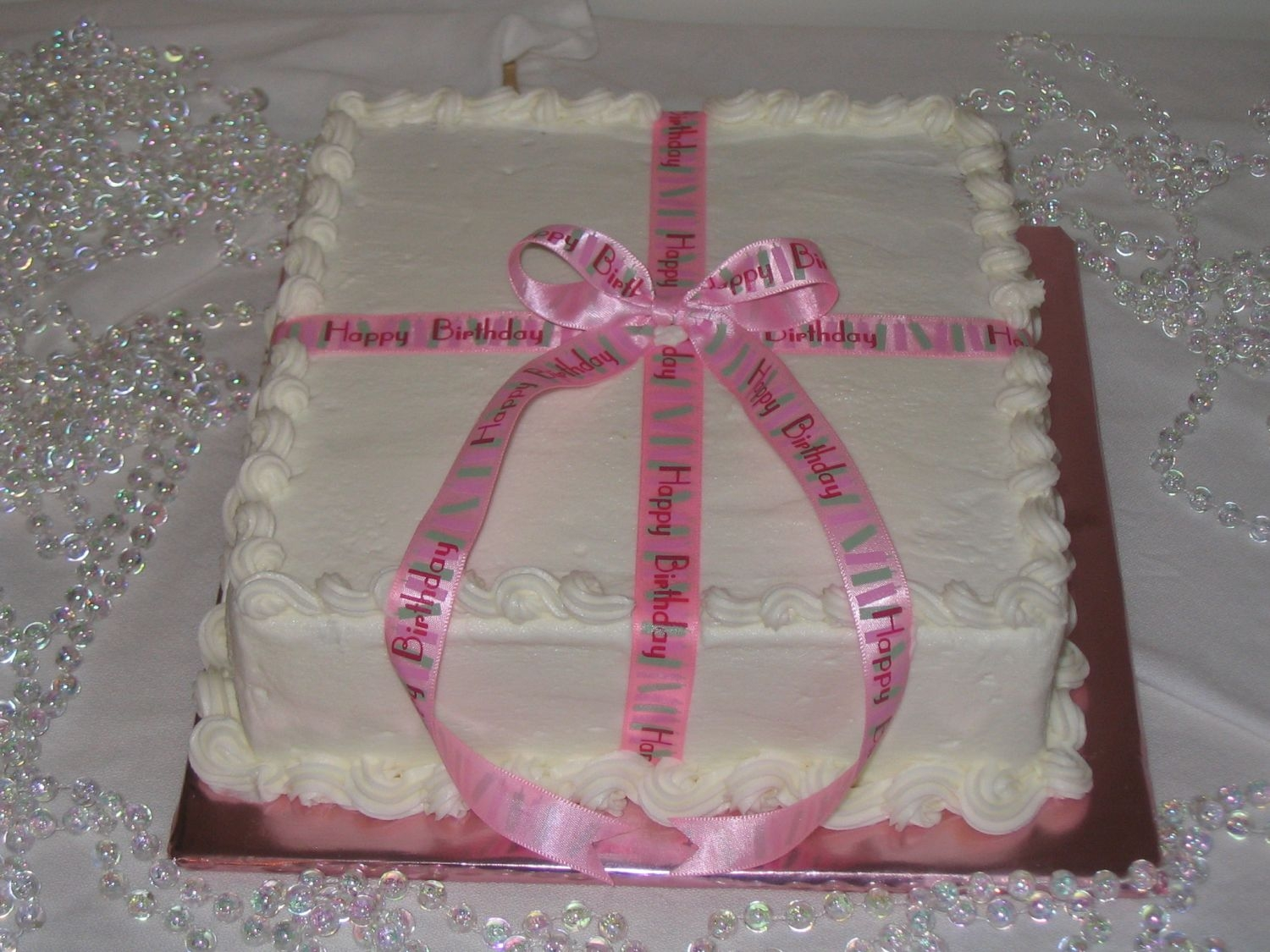 Pink Ribbon Happy Birthday Another cake for a girl in my class. She called me on short notice and said she wanted a simple cake for her birthday and to just suprise...
