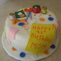 Sewing choc cake w/strawberry filling. Cake is covered with MMF. All details are fondant. ty for looking.