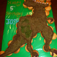 T-Rex Cupcake Cake Break-away cupcakes..much easier than cutting cake at a kids birthday party!