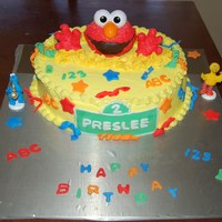 Preslees Elmo Cake I made this for a little girls who is turning 2 and she loves elmo. Vanilla cake with buttercream icing. Fondant decorations. Thanks for...