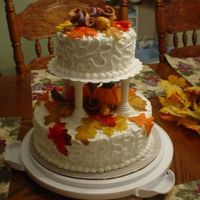 Fall Wedding Cake I did this cake for Wilton Course 3 class! I made it through all three courses..Yipee! Yellow cake with buttercream icing. Decorations were...