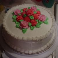 Roses White cake with buttercream icing. Roses are also buttercream. This was a practice rose cake.