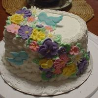 Course 2 Cake Made with buttercream, Royal icing flowers, and Color Flow Birds. It is a four layer red velvet cake with Buttercream in each layer. I had...