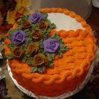 Fall Cake A fall cake. One 10 inch round chocolate cake torted and filled with buttercream and rasberry perserves filling. Basket weave with...