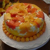 Fall Cake This is a cake that I did for fun. It was a white cake with strawberry perserves filling. It was covered in fondant and the decorations...