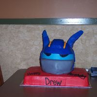 Optimus Prime Buttercream with a little bit of fondant. Antennas (if that's what you call them) were rice krispie treats....first time using rice...