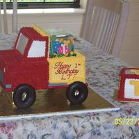 Dump Truck   dump truck and smash cake. cargo is fondant presents. wheels are choc. covered donuts
