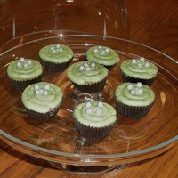 Mini Green Tea Cupcakes Green tea cake with green tea icing, edible pearls on top.