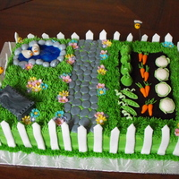 Garden  I had a lot of fun making this one :) The mini veggies were my favourite part. Gumpaste veggies, flowers, bench, bees and ducks. Other...
