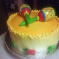 Fiesta!! Very loud fun cake!!!! Haha. The accents are party favors, the icing is buttercream, sprayed with yellows and oranges!