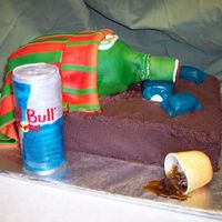 Jager Cake There was an episode of Ace of Cakes where they made a cake with a passed out Tequila bottle in a bed. Well this was my version, using...
