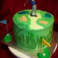 Tee Time Lemon pound cake with buttercream icing, sprayed green. The top.... used a grass tip, the water, blue tinted piping gel, the sand traps,...