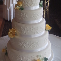 Opal-Innocence Inspired White piping on ivory fondant with hand-sculpted flowers.