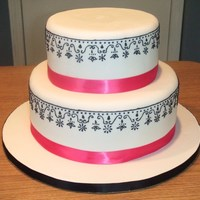 Pink White & Black Black piping on white fondant.