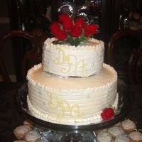25Th Wedding Anniversary first time using buttercream frosting, vanilla pudding in the center, fresh roses for topper, white chocolate for the monogram. Accented...