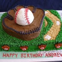 "Baseball Theme  9x13 base with buttercream icing and grass tip. 9"" round carved down to form the glove wit h buttercream icing. Baseball is from a..."