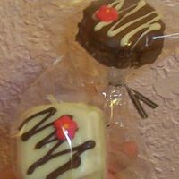 Christmas Cake Truffles On A Stick   The chocolate started to crack, the cake truffle was used frozen and made the chocolate crack. Need to work through that..