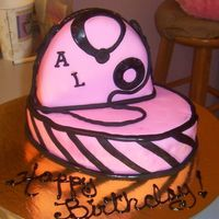 Pink And Black Purse Cake  one of the spa girls says it's her birthday, can I make her a cake..anything,whatever I had..so I pulled a small oval cake I had been...