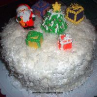 Christmas Cake This is a chocolate cake, covered in BC and coconut to look like snow. Added edible spinles to give it that sparkle like snow. Fondant...