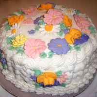 A Slice Of Spring Royal icing flowers with buttercream basketweave.